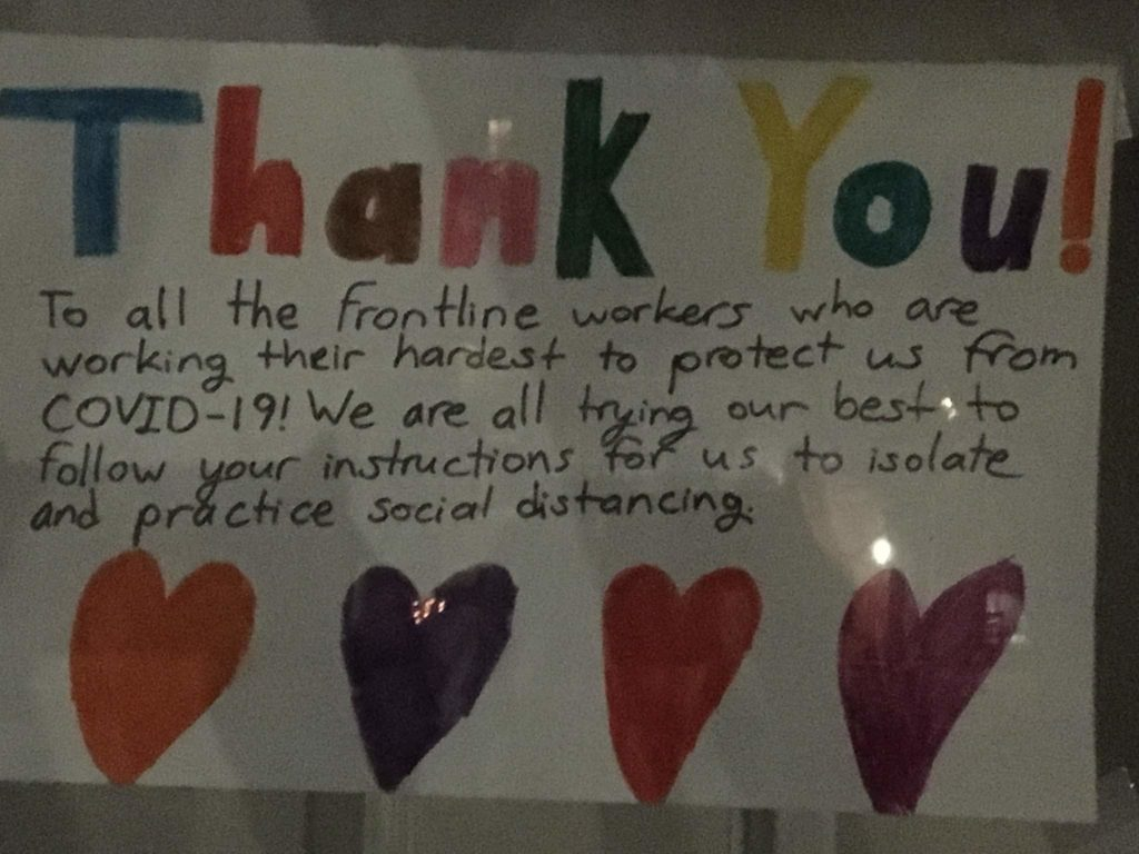 """Handwritten sign, with hearts: """"Thank you to all the frontline workers, who are working their hardest to protect us from COVID-19! We are all trying our best to follow your instructions for us to isolate and practice social distancing"""""""