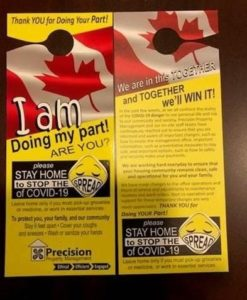 """Door signs reading """"I am doing my part, are you? Stay home to stop the spread of COVID-19"""""""