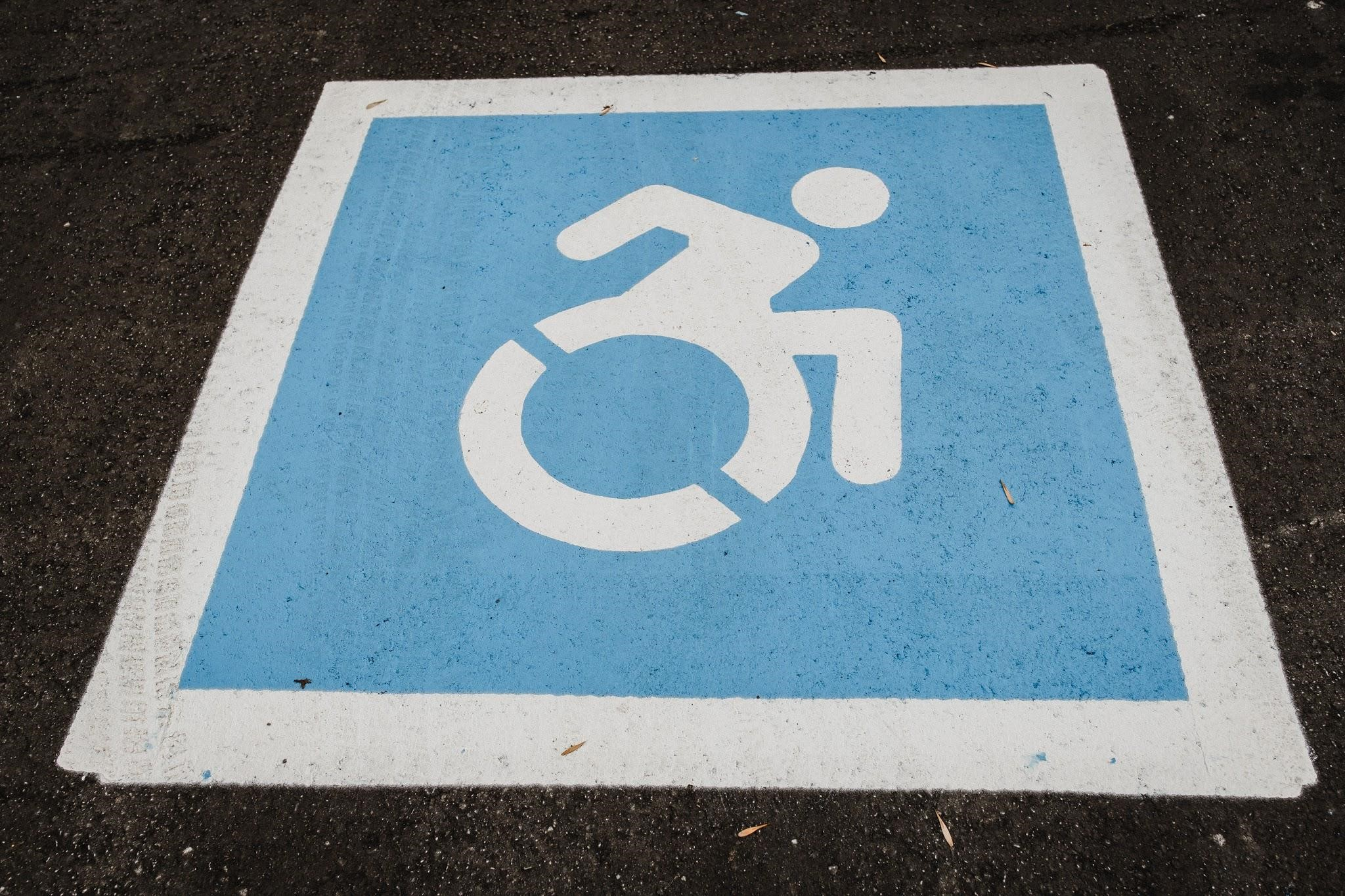 A symbol of a wheelchair user in an accessible parking space