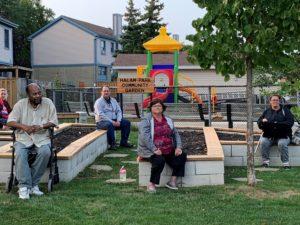 Co-op members sit in front of Halam Park Co-op's community garden